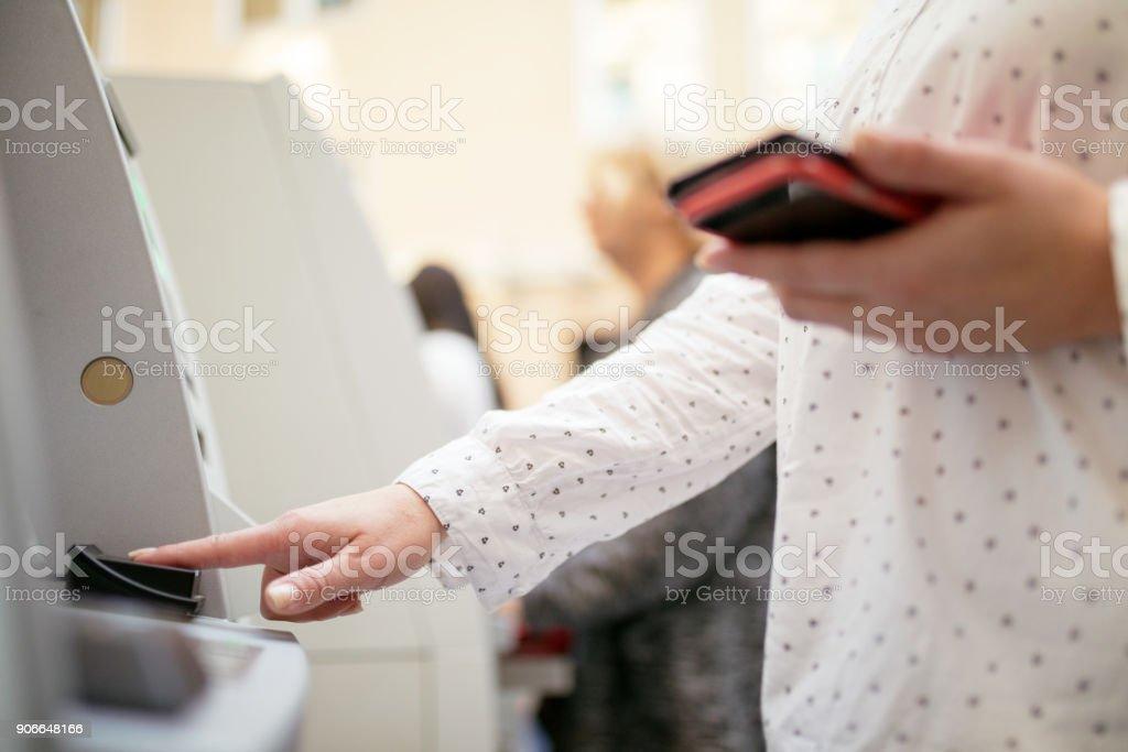 Fingerprint recognition on ATM stock photo