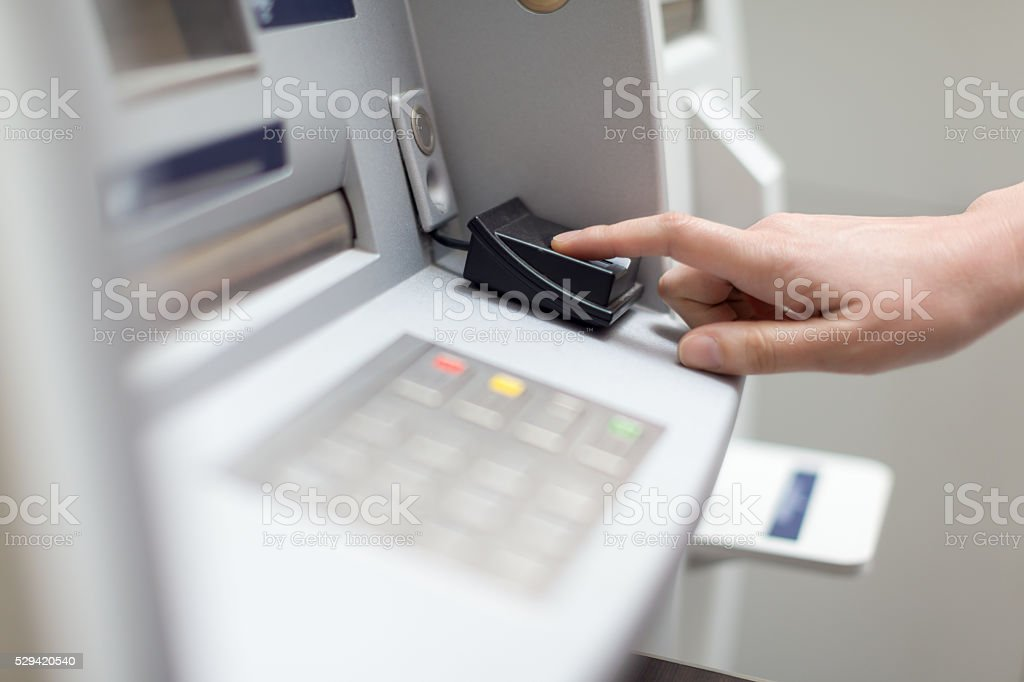 Fingerprint recognition technology on ATM stock photo