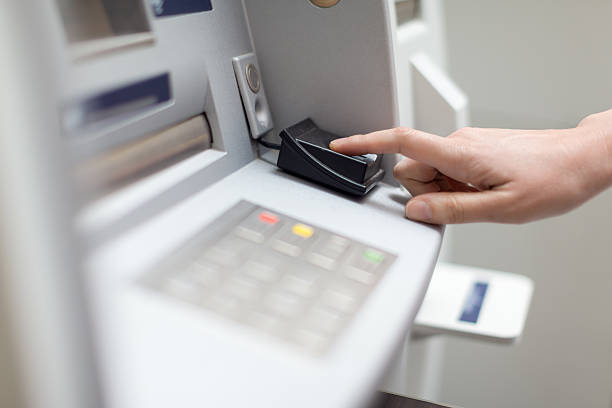 Fingerprint recognition technology on ATM stock photo