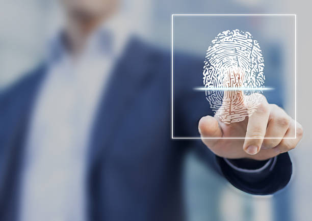 Fingerprint scan provides security access with biometrics identification Fingerprint scan provides security access with biometrics identification, person touching screen with finger in background biometrics stock pictures, royalty-free photos & images
