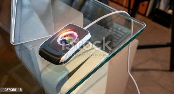 1058987638 istock photo Fingerprint scanner on glass table for check-in security system. Fingerprint and password lock in a office building, The fingerprint scanner control machine for record work time, unlock door office. 1087059116