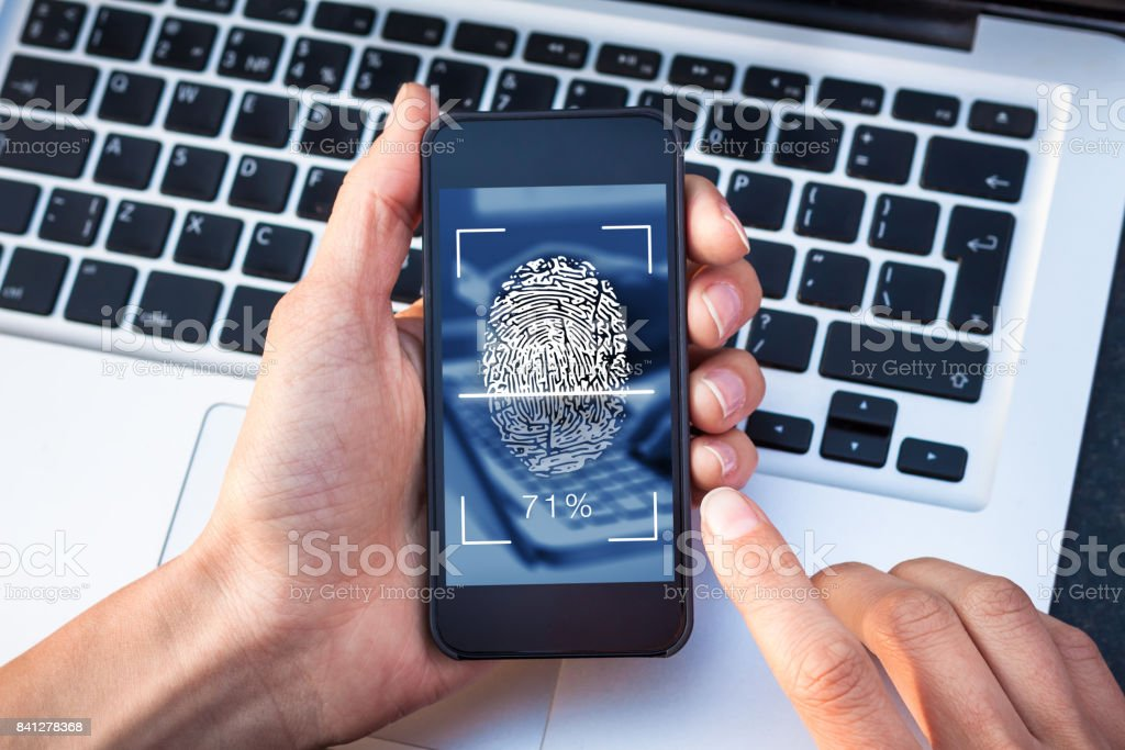 Fingerprint scanning on smartphone screen, finger touching biometric cybersecurity scanner stock photo