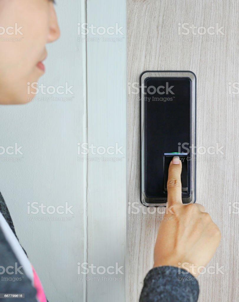 Fingerprint used as an identification method on a door lock stock photo