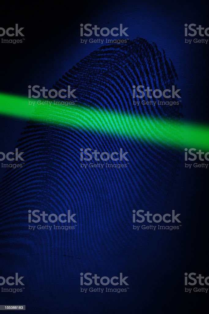 Fingerprint with laser beam royalty-free stock photo