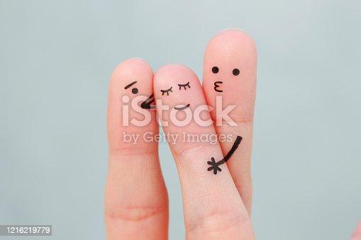 Fingers art. Concept boys kisses of girl on cheek.