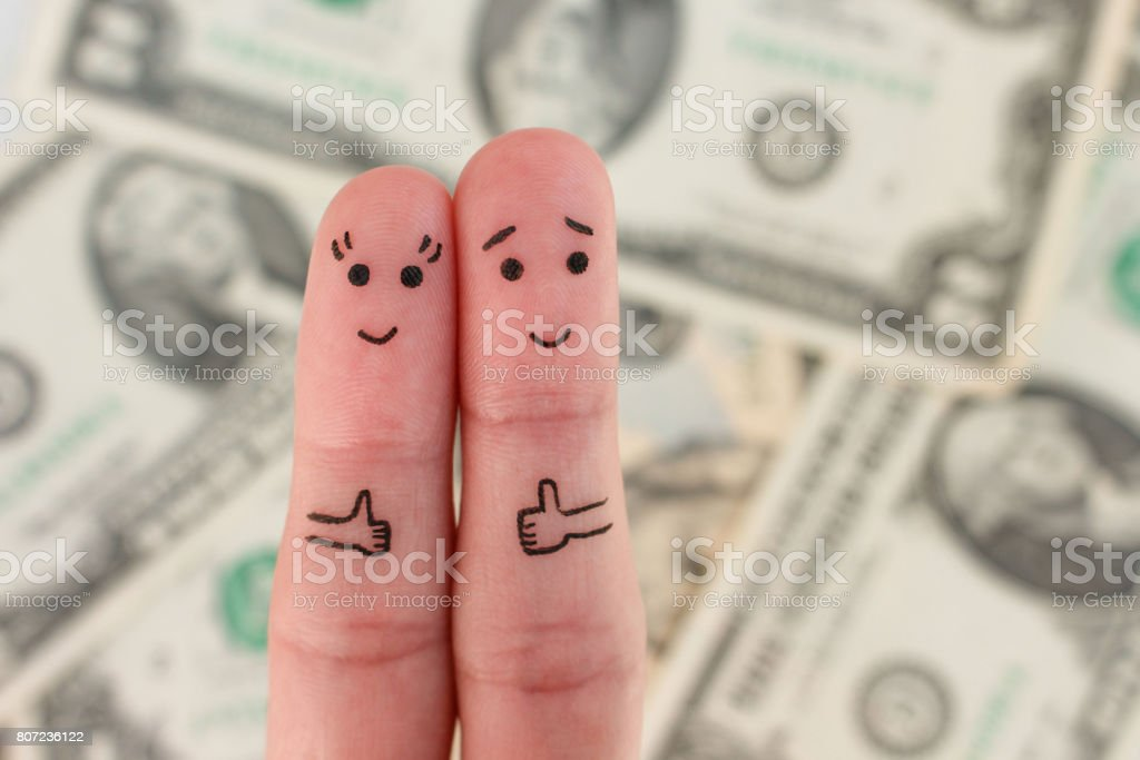 Fingers art of a Happy couple. Man and woman show sign of class on background of money. stock photo