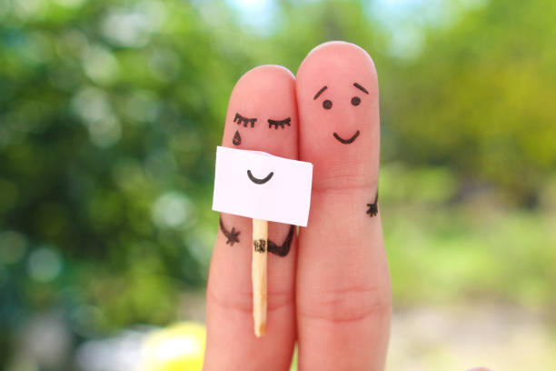 Fingers art of couple. Concept of woman hiding emotions, man is happy. Fingers art of couple. Concept of woman hiding emotions, man is happy. cheesy grin stock pictures, royalty-free photos & images
