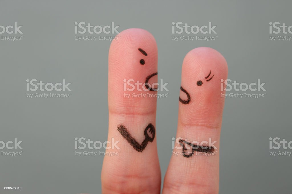 Fingers art of couple in quarrel. Man and woman swear. stock photo