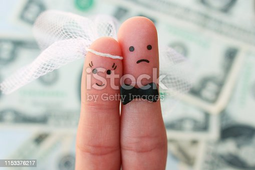 Fingers art of couple on background of money. Concept of woman is happy, and man does not want to get married.