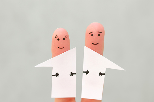 istock Fingers art of family after divorce. Concept of man and woman divided house in half. 1173552359