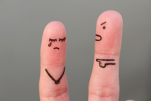 istock Fingers art of family during quarrel. Concept of husband shouts on wife 883102556