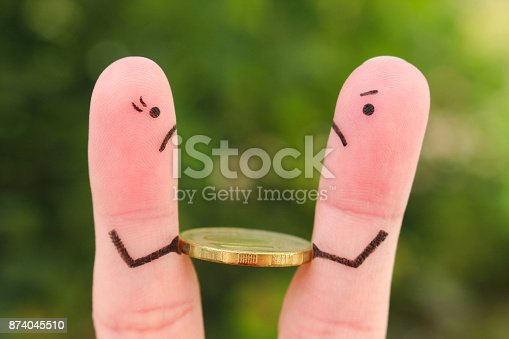 istock Fingers art of family during quarrel. Concept of man and woman cannot divide money after divorce. 874045510