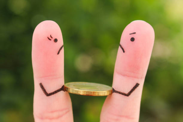 Fingers art of family during quarrel. Concept of man and woman cannot divide money after divorce. Fingers art of family during quarrel. Concept of man and woman cannot divide money after divorce. greed stock pictures, royalty-free photos & images