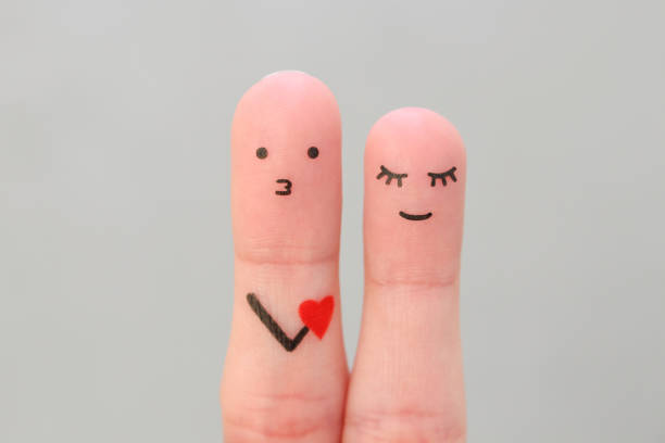 fingers art of happy couple. concept of man confessing his love to woman. - kids kiss embarrassed foto e immagini stock