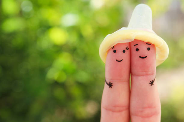 Fingers art of Happy couple. Concept of safe sex. stock photo