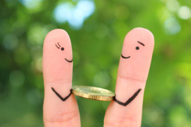Fingers art of happy people. Concept of man giving a bribe. Fingers art of happy people. Concept of man giving a bribe. borrowing stock pictures, royalty-free photos & images
