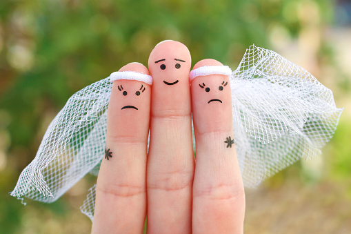Fingers art of people. Plural marriage.