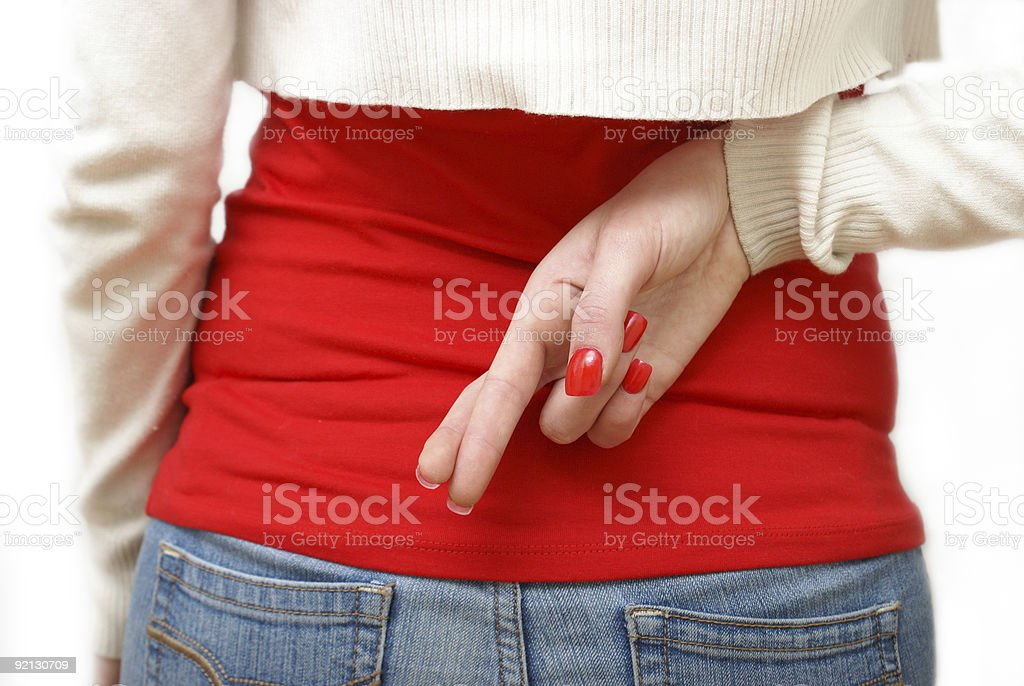 Fingers Crossed Behind Back stock photo