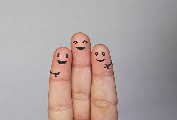 fingers family - three people stock photos and pictures