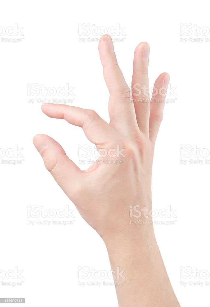 Fingers hold small object stock photo