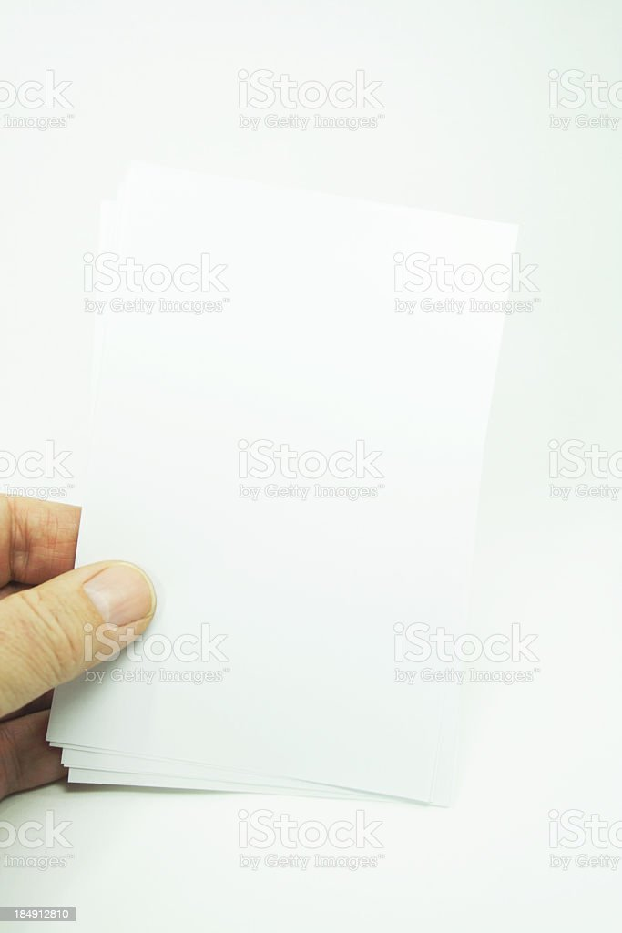 Fingers Holding White Note Cards royalty-free stock photo