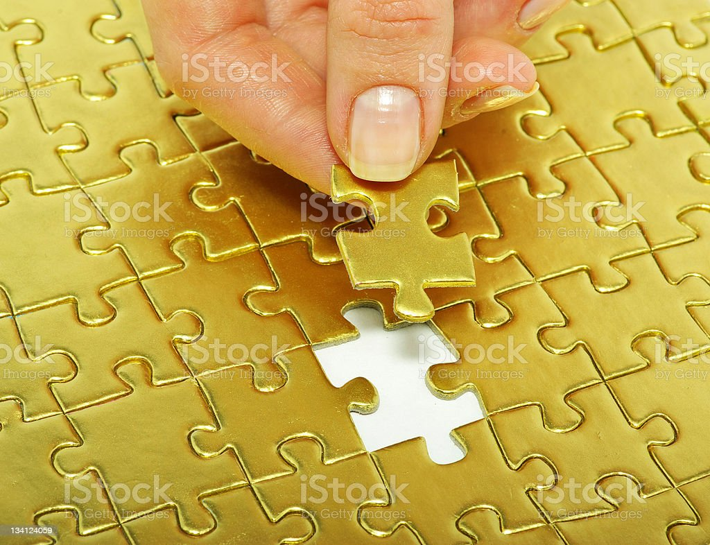 fingers holdings  puzzle royalty-free stock photo