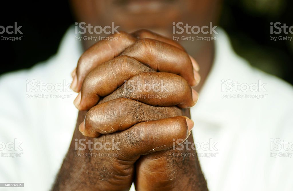 fingers of afro man clasped royalty-free stock photo