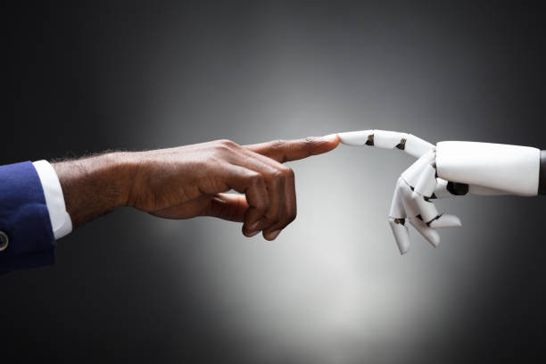 fingers of robot and man touching - human finger stock pictures, royalty-free photos & images