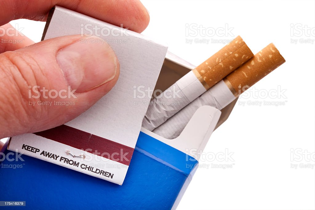 Fingers offering cigarettes with matches saying, ' Keep Away From Children' stock photo