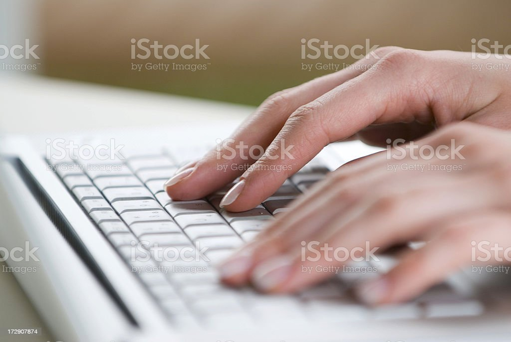 Fingers on a computer keyboard royalty-free stock photo