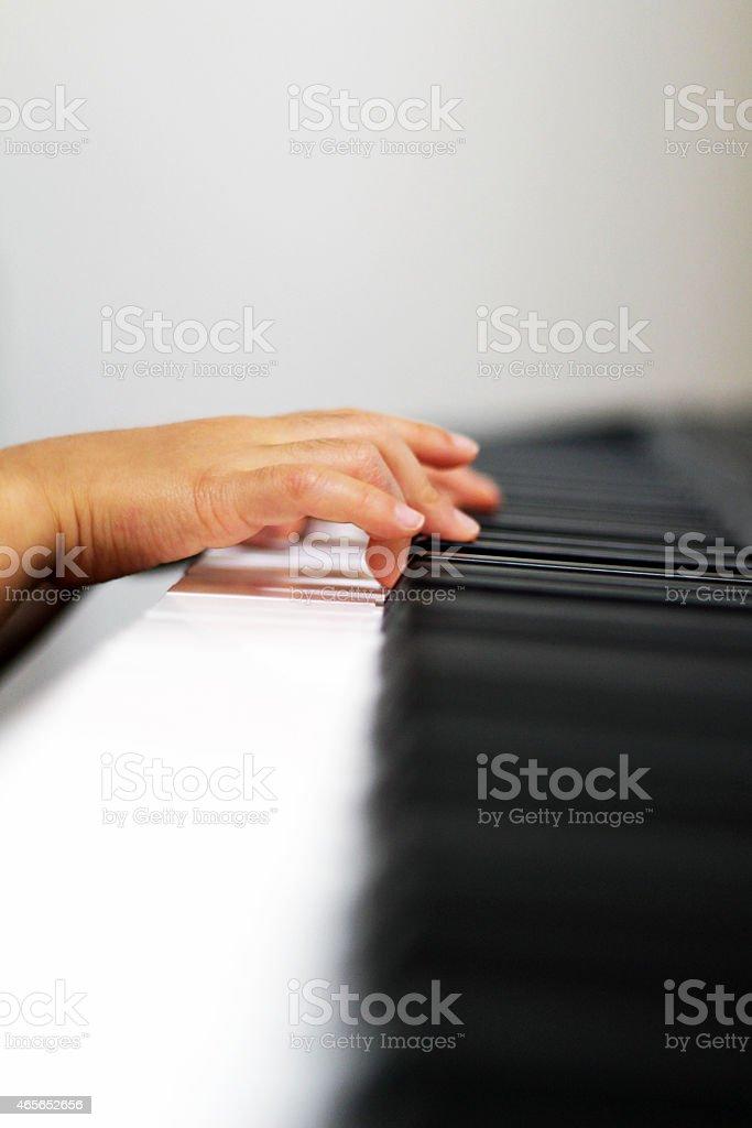 Fingers on a piano keys stock photo