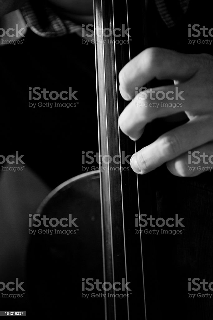 fingers playing cello stock photo