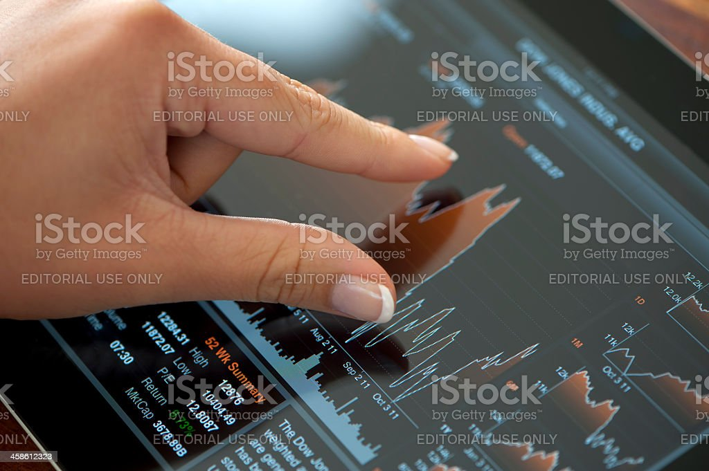 Fingers touching a digital tablet royalty-free stock photo