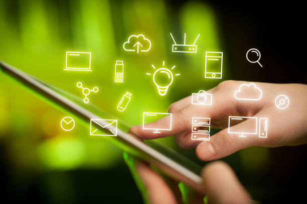 Fingers touching tablet with icons stock photo