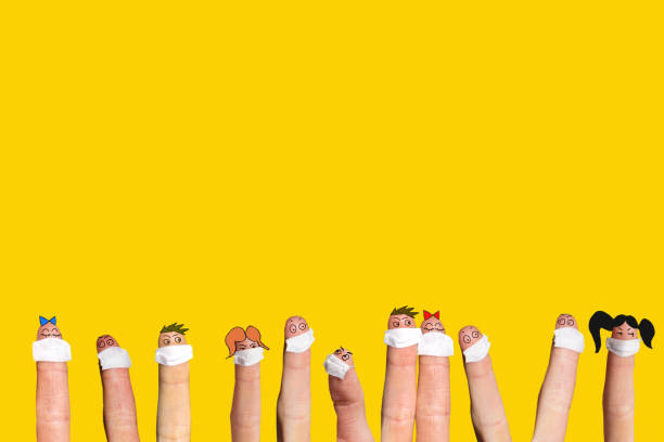 Fingers wearing mask on funny faces stock photo