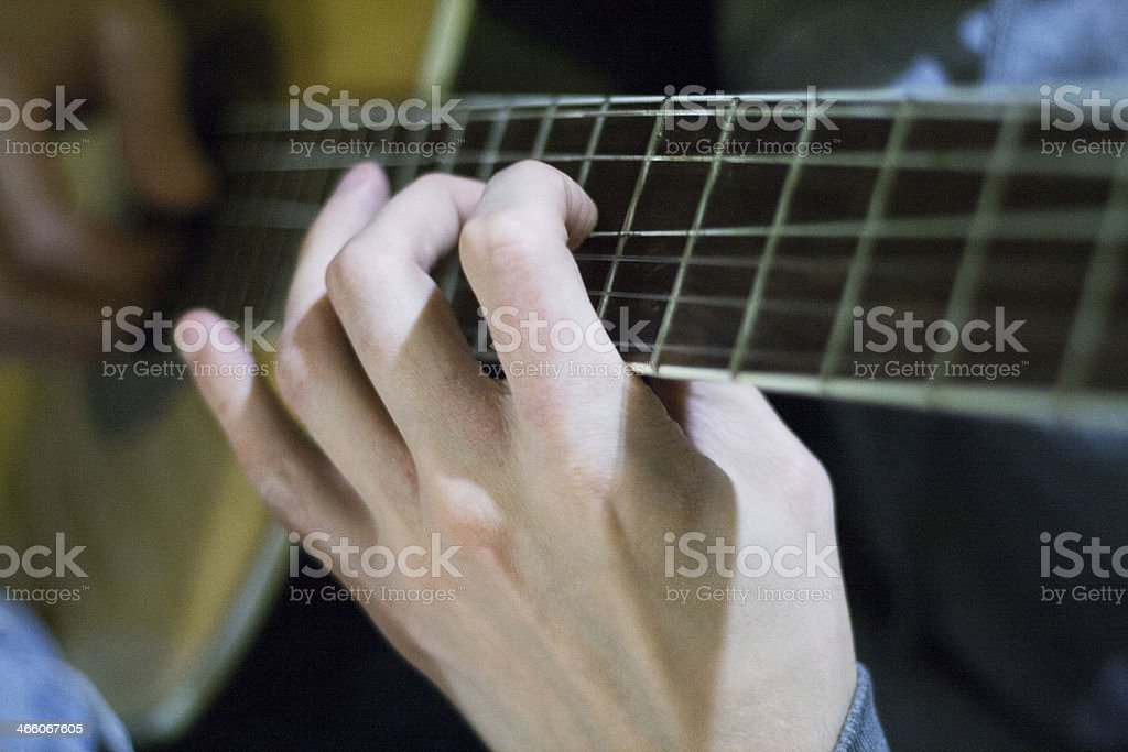 Fingersetting on guitar neck royalty-free stock photo