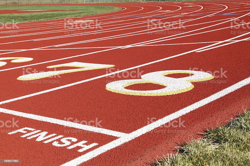 Finish Line and Beyond on Red Running Track royalty-free stock photo