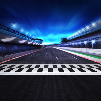 istock finish line on the racetrack in motion blur with stadium and spotlights 1055955480