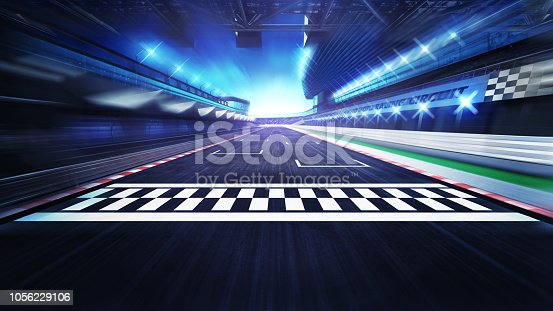 istock finish line on the racetrack with spotlights in motion blur 1056229106