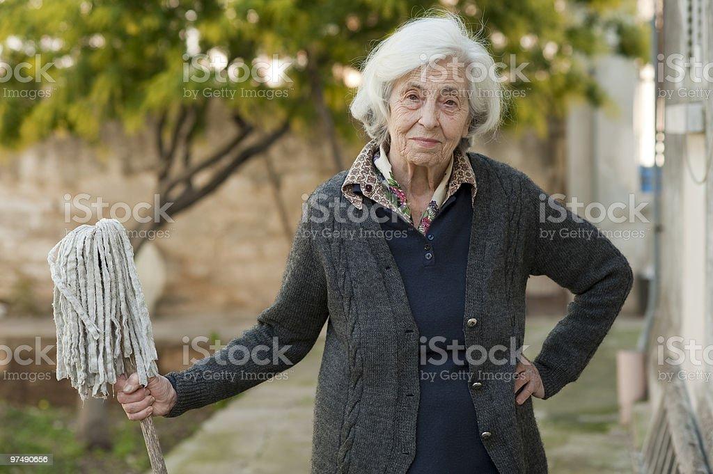 Finish! (Senior woman and mop) royalty-free stock photo