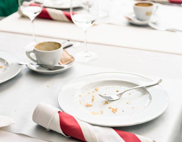finished meal at restaurant table - tallrik uppätet bildbanksfoton och bilder