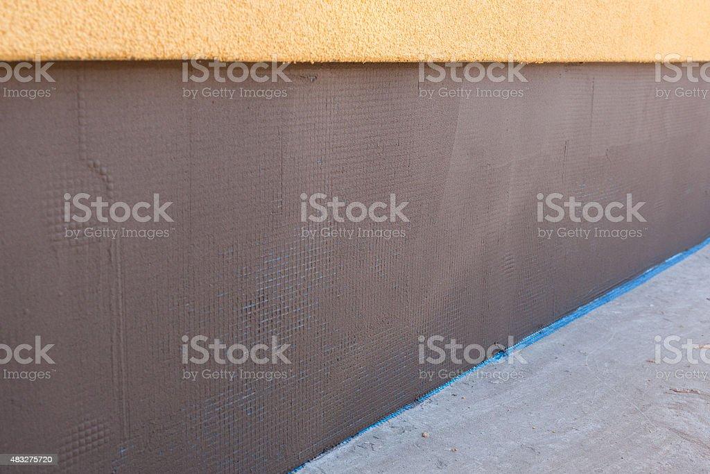 Finished plastered house foundation stock photo
