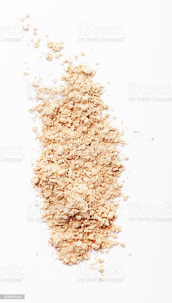 Finishing face powder on white background stock photo