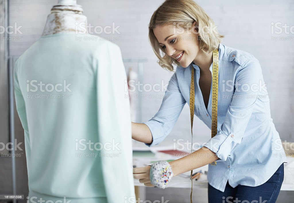 Finishing her first garment stock photo