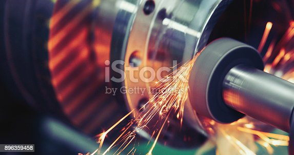 istock Finishing metal working on high precision grinding machine in workshop 896359458