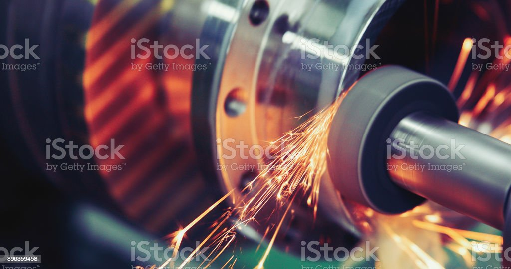 Finishing metal working on high precision grinding machine in workshop stock photo