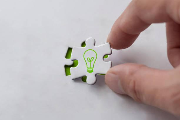 Finishing puzzle with new idea stock photo