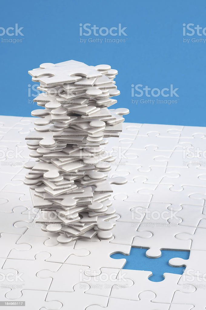 finishing the jigsaw, but wich is right? royalty-free stock photo