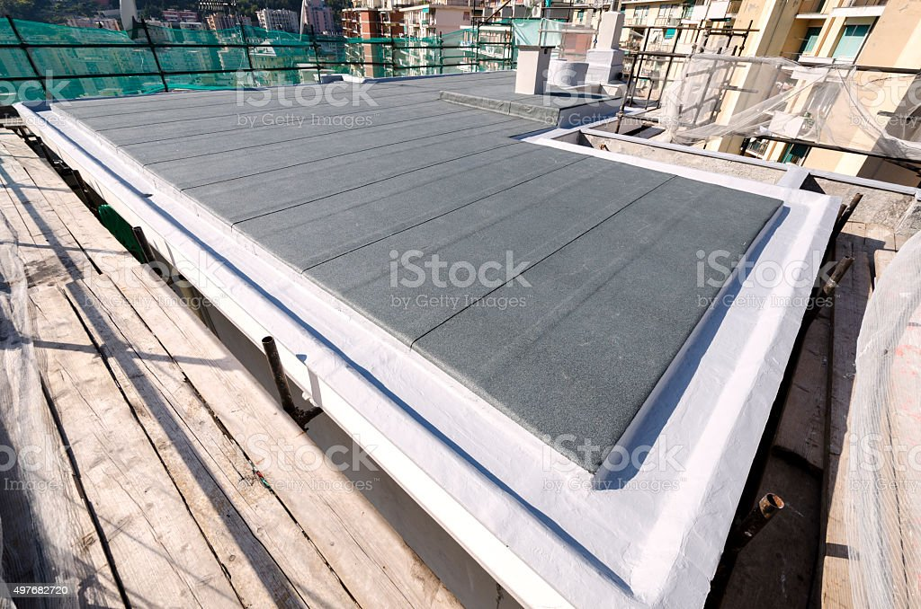 Finishing the roof of a building stock photo