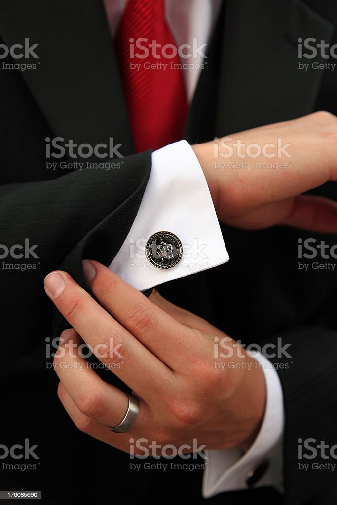 Finishing Touch On Suit - Cufflink royalty-free stock photo